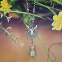 Hummingbird Neckalce with Tiny Bottle and Flower by VintageLightJewelry