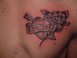 heart on chest by tattooistgus