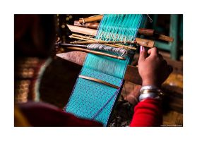 long neck woman weaving by lightdrafter