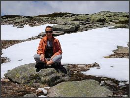 Sitting in a snow field in May by Arte-de-Junqueiro