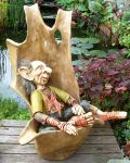 Troll in wooden chair by Gniffies