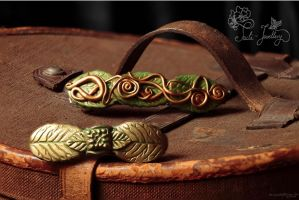 Brass serpents and Golden rose leaf barrettes by Tuile-jewellery