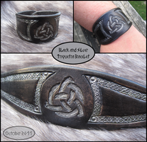 Black+Silver Triquetra Bracele by TheScreamingNorth