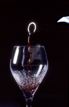 Wine Pouring into Glass by dworld