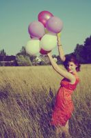 A girl with balloons by Emmilli