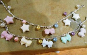 Pastel bow bracelets by ilikeshiniesfakery