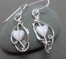 Love Entwined Heart Earrings by sojourncuriosities