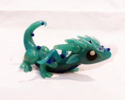 Playful Baby Water Dragon by ByToothAndClaw
