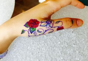 Hand Flower Tattoo by Joanne01134