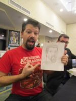 Chris Duppenthaler holding Quick Drawing by Poorartman