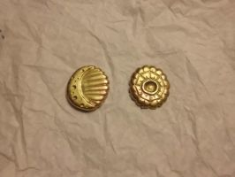 carved brass medallions by crazyandconfusedone