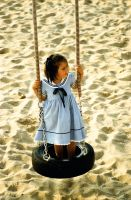 Beach swing with girl by mister-softy