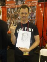 Brian Pulido holding his quick drawing by Poorartman