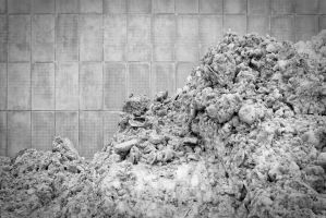 FUJI2333 or Dirty snow in front of a concrete wall by wchild