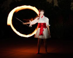 Performing with flame by Arachnoid