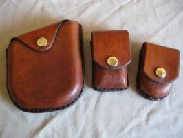 Formed Leather Pouches by passbyguy