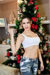 Christmas Lara Croft cosplay - with desert eagle by TanyaCroft