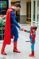 Superman and SpiderKid shake hands. by Crazy-J19