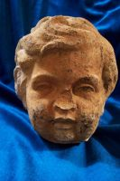 Child's face, statue by paintresseye