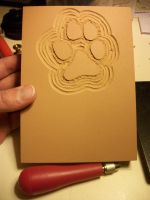 Doggy paw print stamp carving by VibrantVoid