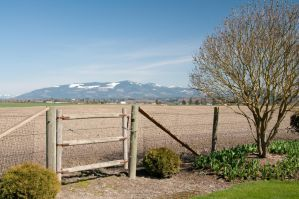 Fence with Gate and Mountains by happeningstock