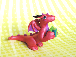Pink Present Dragon by KuddlyKreatures