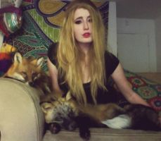 A girl and her foxes by Brillyent-Blondie