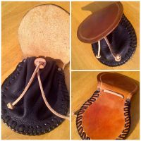 Leather pouch by passbyguy