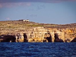 Coast of Comino by Ajumska
