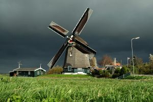 Windmill with dark Sky by rblokker