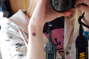 Star tattoo by Photogenic5
