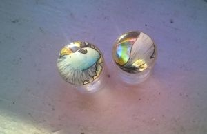 holographic 1/2 inch Vaporeon plugs by HiddenStash