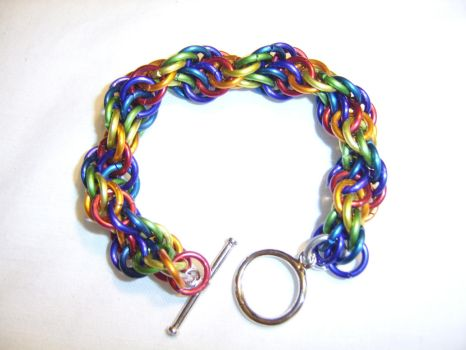 commission: dual-spiral rainbow bracelet by ArcMoonblade