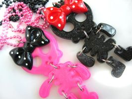 Girly Skelly necklaces by pinkminx