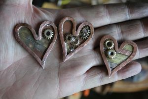 Three hearts of brass, copper, and cogs by connerchristopher