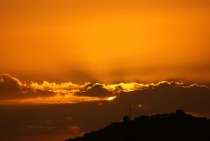 the Sun sets behind the cross by QueenoftheLyake