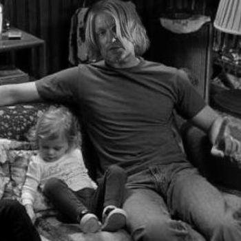 Haymitch and his young daughter by FlutteringPhalanges