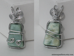 Celtic Swirls wire-wrapped pendant by Animus-Panthera