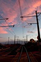 Railway crossing sunset by westcoastwitch