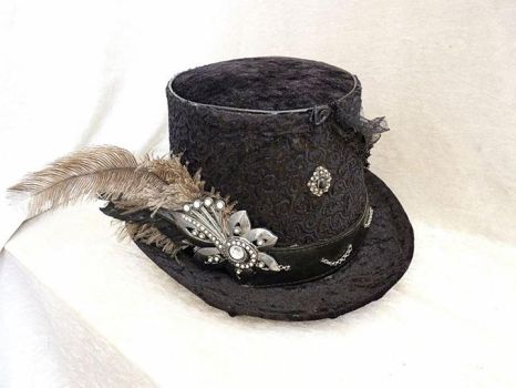 Black velvet top hat with a silver flower by Serata