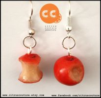 Asymmetric bitten apple earrings by citruscouture