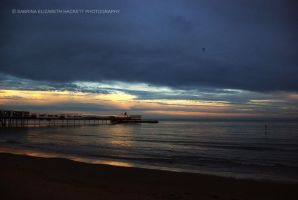 By the Pier Light the Horizon takes the Sun by Hitomii