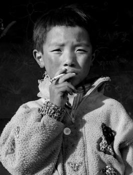 tibet -- child smoking by emma510