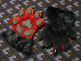 Red and Black Wolf Paws by VenturertheHybrid