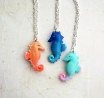 Ombre seahorse necklaces by FlowerLandBySaraMax