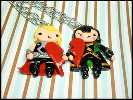 Thor/Loki Heart Necklace Set by GrandmaThunderpants
