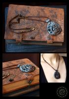 Cratered polymer clay pendant necklace by ZombieArmadillo