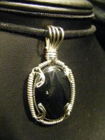 hematite in silver prong bezel by BacktoEarthCreations