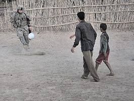 Playing soccer by Soldier-Photographer