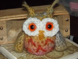 Orange and other colors variegated owlet by Amigurumi-Lover